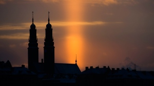 The sun sets against a Stockholm skyline on Jan. 7, 2016. (Henrik Montgomery / TT News Agency via AP)