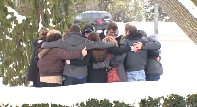 Friends and family of Nicole Wagler embrace outside of the Perth County court house. January 24, 2016