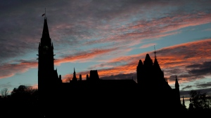 In this file photo, Parliament Hill is seen at sunset on Thursday, Oct. 23, 2014. (THE CANADIAN PRESS / Justin Tang)
