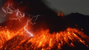 Lightning flashes above flowing lava as Sakurajima, a well-known volcano, erupts Friday evening in southern Japan. Japan's Meteorological Agency said Sakurajima on the island of Kyushu erupted at around 7 p.m. local time. (Kyodo News)