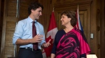 Prime Minister Justin Trudeau and B.C. Premier Christy Clark speak at the start of a meeting on Parliament Hill in Ottawa, On Friday February 5, 2016. (THE CANADIAN PRESS / Adrian Wyld)
