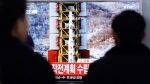 People watch a TV news reporting a rocket launch in North Korea, at Seoul Railway Station in Seoul, Sunday, Feb. 7, 2016. (Ahn Young-joon / AP)