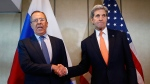 Russian Foreign Minister Sergey Lavrov, left, and U.S. Secretary of State John Kerry shake hands in Munich, Germany, on Feb. 11, 2016. (Matthias Schrader / AP)