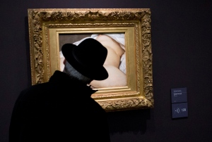 A visitor looks at Gustave Courbet's 1866 'The Origin of the World,' painting which depicts female genitalia at Orsay museum, in Paris, France, Friday, Feb. 12, 2016. (AP Photo/Francois Mori)