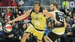 Team Canada's Win Butler, left, drives past Team USA's Joel David Moore during the NBA celebrity all-star game in Toronto on Friday February12, 2016. (THE CANADIAN PRESS / Chris Young)