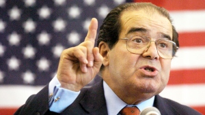 In this Wednesday, April 7, 2004 file photo, U.S. Supreme Court Justice Antonin Scalia speaks to Presbyterian Christian High School students in Hattiesburg, Miss (The Hattiesburg American via AP / Gavin Averill)