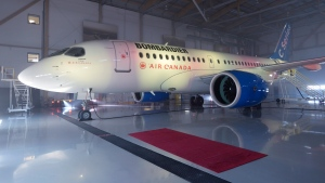 A Bombardier CSeries jet sits in a Montreal hangar on Wednesday, Feb. 17, 2016. (Paul Chiasson / THE CANADIAN PRESS)