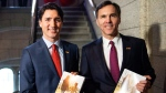 Prime Minister Justin Trudeau walks with Minister of Finance Bill Morneau as he arrives to table the budget on Parliament Hill, Tuesday, March 22, 2016 in Ottawa. (Justin Tang / THE CANADIAN PRESS)