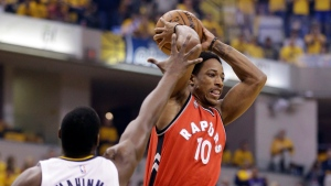 Toronto Raptors' DeMar DeRozan (10) passes against Indiana Pacers' Ian Mahinmi (28) during the first half of Game 6 of an NBA first-round playoff basketball series Friday, April 29, 2016, in Indianapolis. (AP Photo/Darron Cummings)