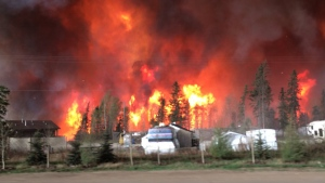 A trailer park engulfed in flames near Fort McMurray, Alta. Tuesday, May 3, 2016. (Breanna Karstens-Smith / CTV News)