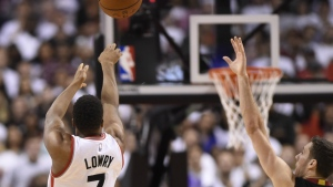 Toronto Raptors' Kyle Lowry scores a three point basket late in the game as Miami Heat's Goran Dragic defends during NBA playoff basketball action in Toronto on Thursday, May 5, 2016. (Frank Gunn / THE CANADIAN PRESS)