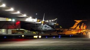 Pilot Andre Borschberg lands the Swiss-made Solar Impulse 2 plane in Goodyear, Ariz. on Monday, May 2, 2016. (AP / Matt York)