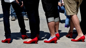 Lebanese men walk in high heels during an event called 'Walk a Mile in Her Shoes,' in Beirut, Lebanon, on April 26, 2015. (Hussein Malla / AP)