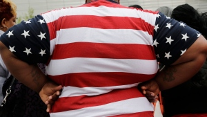 In this May 8, 2014 file photo, an overweight person is seen in New York.  (AP /Mark Lennihan, File)