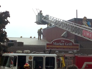 Firefighters work to control a fire at the Peddler's Village building at the St. Jacobs Farmers' Market on Thursday, May 26, 2016. (Max Wark / CTV Kitchener)
