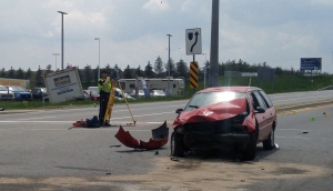 A three-vehicle crash sent one woman to hospital and closed Highway 7/8 at Peel Street in New Hamburg on Friday, May 27, 2016. (Dan Lauckner / CTV Kitchener)
