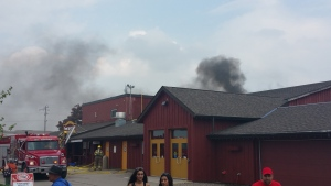 Black smoke rises from Peddlar's Village at the St. Jacobs Farmers' Market on Thursday, May 26, 2016. (Rac Loh / MyNews)
