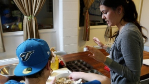 "A resident of a youth group home participates in a ""food literacy"" cooking class in London, Ontario, Tuesday, January 10, 2012. (THE CANADIAN PRESS/Dave Chidley)"