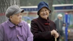 Wlderly women chat as they rest at a residential compound in Beijing on March 31, 2016. (AP / Andy Wong)