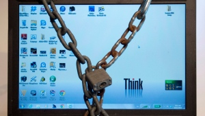A photo illustration made December 14, 2012 in Montreal shows a computer in chains. (THE CANADIAN PRESS/Ryan Remiorz)