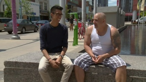 Justin Chan talks to Chris, one of the people profiled by Homeless in Waterloo, on Friday, June 24, 2016.