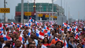 Thousands of spectators watch as the Neopanamax cargo ship, Cosco Shipping Panama, makes its way through the new Agua Clara locks, part of the Panama Canal expansion project, near the port city of Colon, Panama, on Sunday, June 26, 2016. (AP Photo/Moises Castillo)