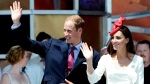 The Duke and the Duchess of Cambridge wave to cheering crowds as they take part in Canada Day festivities on Parliament Hill in Ottawa on Friday, July 1, 2011. (THE CANADIAN PRESS / Sean Kilpatrick)