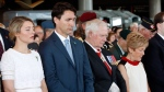 Heritage Minister Melanie Joly, left to right, Prime Minister Justin Trudeau, Governor General David Johnston and his wife Sharon, bow their heads for a moment of silence in commemoration of the 100th anniversary of the Battles of the Somme and Beaumont-Hamel, at the National War Museum in Ottawa, Friday, July 1, 2016. THE CANADIAN PRESS/Fred Chartrand