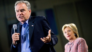 Democratic presidential candidate Hillary Clinton, right, listens as Sen. Tim Kaine, D-Va., speaks at a rally at Northern Virginia Community College in Annandale, on Thursday, July 14, 2016. (AP Photo/Andrew Harnik)