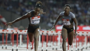 Kendra Harrison of the US, left, crosses the line to win the women's 100 metre hurdles in a world record time of 12.20 seconds during the Diamond League anniversary games at The Stadium, in the Queen Elizabeth Olympic Park in London on Friday, July 22, 2016. (AP / Matt Dunham)