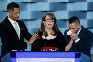 Christine Leinonen, the mother of Christopher 'Drew' Leinonen, who was killed in the nightclub attack in Orlando, is joined on stage by Brandon Wolf, survivor of the nightclub attack in Orlando., and Jose Arraigada, survivor of the nightclub attack in Orlando., as she speaks during the third day of the Democratic National Convention in Philadelphia , Wednesday, July 27, 2016. (AP / J. Scott Applewhite)