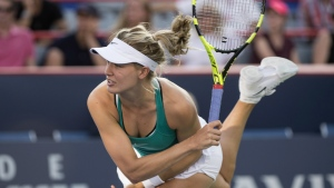 Eugenie Bouchard serves to Dominika Cibulkova during second round of play at the Rogers Cup tennis tournament in Montreal on Wednesday July 27, 2016. (Paul Chiasson / THE CANADIAN PRESS)
