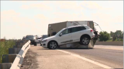 Tanker truck and SUV collide, causing the SUV to lose control and a trailer to tip