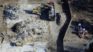 Workers use backhoes to remove rubble during the demolition of Sandy Hook Elementary School in Newtown, Conn., where gunman Adam Lanza killed 20 children and six adult educators on Dec. 14, 2012, in this photo taken on Oct. 28, 2013. (AP / Jessica Hill)