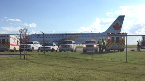 The plane landed safely in Lethbridge after cracking a windshield in flight.