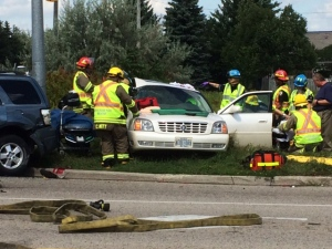 Firefighters work at the scene of a collision at King Street North and Northland Road in Waterloo on Wednesday, Aug. 24, 2016. (Kyle Bowden / CTV Kitchener)