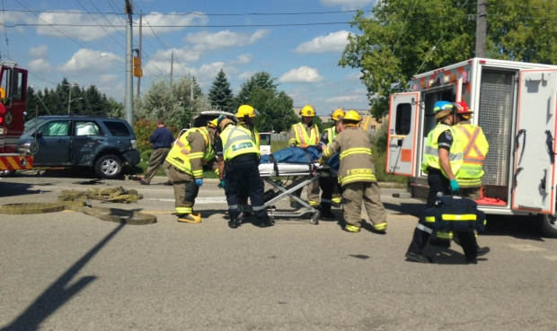 A person is loaded into an ambulance following a serious collision at King Street North and Northland Road in Waterloo on Wednesday, Aug. 23, 2016. (Alexandra Pinto / CTV Kitchener)