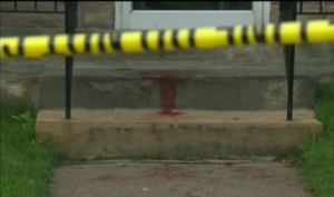 Blood stains the front stairs to a Kitchener apartment building