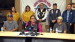 Former Manitoba aboriginal affairs minister Eric Robinson, front centre, speaks next to David Tait Jr., front right, and Lee Swanson, front left, about DNA evidence that the two men were switched at birth, in Winnipeg, Friday, Aug. 26, 2016.