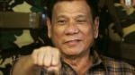 Philippine President Rodrigo Duterte gestures with a fist bump during his visit to the Philippine Army's Camp Mateo Capinpin at Tanay township, Rizal province east of Manila, Philippines on Wednesday, Aug. 24, 2016. (AP / Bullit Marquez)