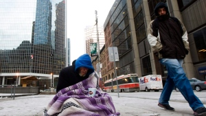 A homeless person panhandles for money during an extreme cold weather alert for the City of Toronto on Monday, Dec. 13, 2010. (Nathan Denette / THE CANADIAN PRESS)