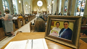 A photograph of Sister Margaret Held of the School Sisters of St. Francis, left, and Sister Paula Merrill, of the Sisters of Charity of Nazareth, is placed at the entrance to the Cathedral of St. Peter the Apostle in Jackson, Miss. on Monday, Aug. 29, 2016. (AP / Rogelio V. Solis)