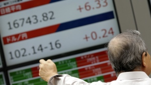 A man looks at an electronic stock board showing Japan's Nikkei 225 index at a securities firm in Tokyo on Tuesday, Aug. 30, 2016. (AP / Eugene Hoshiko)