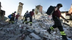 Firefighters carry personal belongings retrieved from houses, in Amatrice, central Italy after last Wednesday's earthquake, in this photo taken on Monday, Aug. 29, 2016. (Massimo Percossi / ANSA)