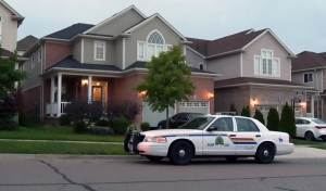 An RCMP cruiser sits outside the home at 430 Robert Ferrie Drive in Kitchener on Wednesday, Aug. 31, 2016.