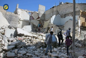 In this photo provided by the Syrian Civil Defense group known as the White Helmets, members of the Civil Defense group and residents inspect damaged buildings after airstrikes hit the Bustan al-Qasr neighbourhood in Aleppo, Syria, Sunday, Sept. 25, 2016.