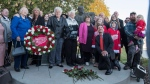 Members of Gordie Howe's family stand for a photograph following the internment of Gordie Howe's remains at the base of a statue of him during a memorial service outside Sasktel Centre in Saskatoon, Sunday, September 25, 2016. THE CANADIAN PRESS/Liam Richards