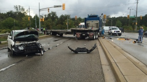 A car and a flatbed truck collided on Homer Watson Boulevard. (Matt Harris / CTV Kitchener)