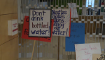 Protest signs at Guelph council on Monday, September 26, 2016
