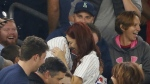 Heather Terwilliger and Andrew Fox embrace after the couple became engaged during a baseball game between the New York Yankees and the Boston Red Sox in New York on Tuesday, Sept. 27, 2016. (AP / Kathy Willens)